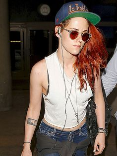 Kristen Stewart always rocks the coolest sunwear! Check her out in crystal clear retro round frames with red tinted lenses!