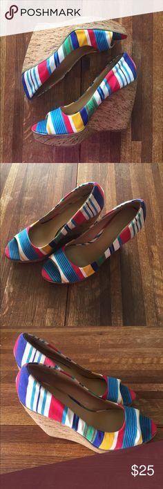 Nine West Rainbow stripe Peep toe wedges Pop of color with these fun cork wedge Peep toe shoes. Great colors, very little sole wear. Canvas outer. Nine West Shoes Wedges