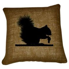 Burlap and cotton pillow with a squirrel silhouette motif.