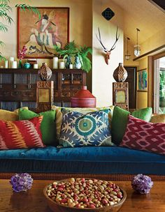 like the pillows, patterns, colors and overall composition of the room