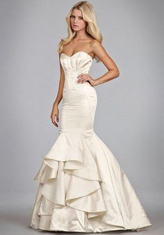 Alabaster tulle bridal gown with halter high neck alabaster and crystal bodice, full horse hair flounced skirt and chapel train.