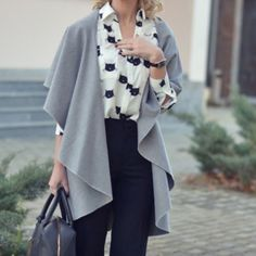 Sleeveless Loose Grey Coat. Used once. Perfect to Too with a long sleeve and a cute scarf . It's one size so fits many different sizes. Not ASOS just for exposure ASOS Sweaters