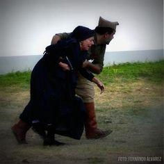 An officer aiding an elderly