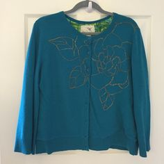Sweater.       ( ANTHROPOLOIE ) NEW LOWER PRICE Used in great condition. Teal outside with yellow -black - green inside also some of the buttons are loose . Beautiful blight bold color's Tabitha Sweaters Cardigans