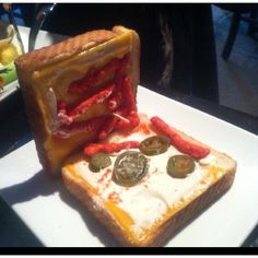 Grilled cheese with jalapeños, cream cheese , and hot Cheetos !