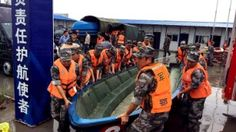 Chinese soldiers carry a boat to search for survivors on June Cruise ship sinks in China's Yangtze River with 458 aboard Sink In, Cruise, Monster Trucks, Boat, Ship, River, World, Soldiers, June