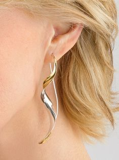 Ribbon Earrings by Nancy Linkin. Elegant simplicity radiates from a precisely tapered curl of sterling silver and 18k gold bimetal, forged using the anticlastic raising technique. Also shown in the additional image is the Undulated Cuff Bracelet