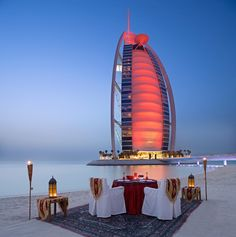 The beach location of Majlis Al Bahar boasts a majestic view of Burj Al Arab. A perfect setting for enjoying a romantic dinner or for watching the sunset over cocktails and snacks. Winter in #Dubai is the ideal time for al fresco dining; Majlis Al Bahar is closed for dinner from June 1st thru September 30th. #BurjAlArab #JetsetterCurator