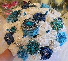 Alternative to a floral bouquet - Vintage pins/brooches used with silk flowers.
