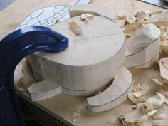 Cut the front and back flippers and the top of the head down to the lower edge of the shell with a No.2 or 3 gouge