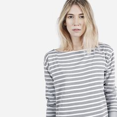 A long sleeve boatneck, cut from 2-ply heavyweight cotton. The shirt features dropped shoulders and side vents. Wear alone or layer like a sweater.