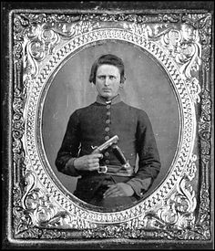 Portrait of Pvt. Robert Patterson, Company D, 12th Tennessee Infantry, C.S.A., with derringer and bowie knife