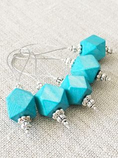 Large lightweight blue wooden stitch markers for knitting. Each marker is beautifully hand made with attention to detail.