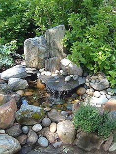 Rockery water feature, woodland? Rocks and cobbles.