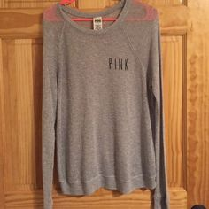 Size small light gray Victoria's Secret pink top Size small Victoria's Secret Pink long sleeve shirt. Material is lightweight. There may be some small areas of slight pulling/pilling, but nothing noticeable while wearing. Loose fitting. PINK Victoria's Secret Tops Tees - Long Sleeve