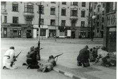 Danish freedom-fighters in a firefight between the remaining German forces in the streets of Copenhagen on the 5th of May 1945.