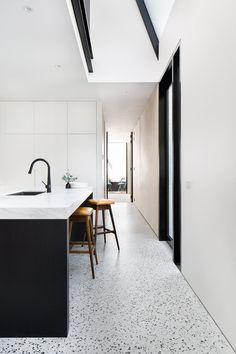 A black and white kitchen with matt polished concrete floors Photography by Emily Bartlett Polished Concrete Kitchen, Concrete Kitchen Floor, White Kitchen Floor, Polished Concrete Flooring, Terrazzo Flooring, Kitchen Flooring, White Concrete, White Flooring, Neutral Kitchen