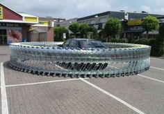 Art of Trolling: car trapped in shopping carts circle