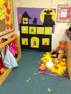 Halloween dramatic play center. Haunted house, pumpkin patch, and costumes.