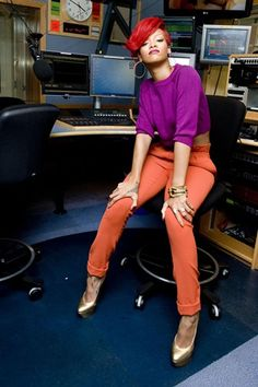 Rihanna Style File OCTOBER 1 2010 - Visiting the Capital FM studios in orange trousers and a purple sweater.