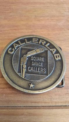 Check out this item in my Etsy shop https://www.etsy.com/listing/207697382/callerlab-square-dance-belt-buckle