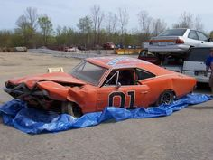 """Today's article is for those muscle car enthusiasts who loved the famous american TV show from the called """"The Dukes of Hazzard"""". The Dukes of Hazzard really wasn't an example of care of cars . My Dream Car, Dream Cars, Hot Wheels, General Lee Car, Junkyard Cars, 1969 Dodge Charger, Car Barn, Abandoned Cars, Car Crash"""