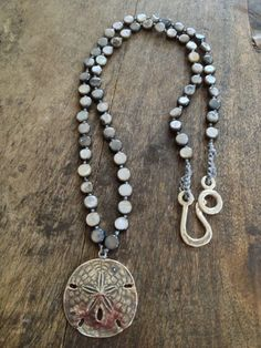 Crochet Necklace Sterling Silver Sand Dollar Pendant Shell Surfer Chic. $39.00, via Etsy.