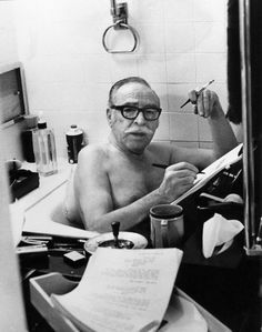 Screenwriter Dalton Trumbo writing in the bath.