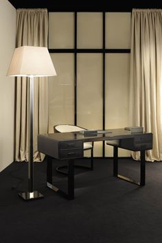 Armchairs from the Metropolitan Home Collection, Armani Casa. Writing desk from the Metropolitan Home Collection.