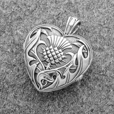 Pendant: Heart and Scottish Thistle Locket – Sterling Silver Celtic Jackalope's Heart und Scottish Thistle Sterling Silber von Maxine Miller FRONT Tartan, Scottish Thistle, Celtic Art, Celtic Dragon, Heart Locket, Sterling Silver Jewelry, Silver Earrings, Silver Jewellery, Silver Bracelets