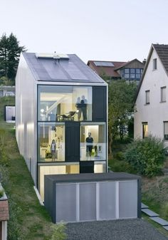 Interior, Fabulous Slim Haus Finckh Architekten Design View From Facade With Clear Glass Window On Three Levels Floor ~ Minimalist White Interior Design from a Contemporary House in Germany