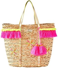 aed9d1aef8 Meet your new favorite beach bag  The Baja Tote. This straw beach tote has  multi-colored embroidery pom-poms and fringe trim details.