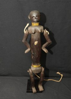 FEMALE PUPPET. Nyamwezi people, Tanzania. Articulated at the hips and shoulders, puppets such as this act as intermediaries through which ancestors and spirits are consulted.