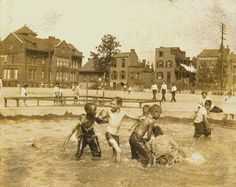 """""""Real Photo"""" - circa 1920's, of children playing in a St. Louis wading pool.  This picture is a rare illustration of black and white children at play during a time when segregation was the rule."""