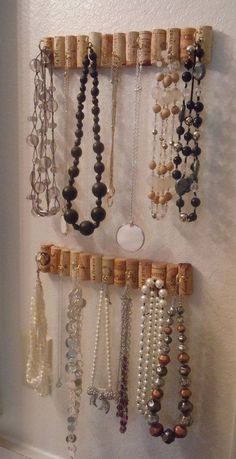 Wine Cork Hooks for Jewelry Storage. Never throw away those wine corks! You can put them in a row and mount them on the wall to make this stylish wall jewelry organizer.