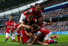 The Arsenal celebrate their equalizer against Manchester City