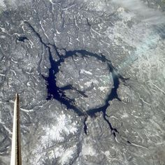 Manicouagan Reservoir, Canada an asteroid crater.  NASA [For some reason, my eyes keep seeing the round island as being in motion, slowly moving away.]
