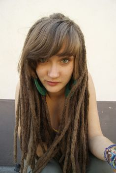 Long, brown dreadlocks.