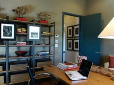 A wall of industrial-style étagères provide for both art display and storage in this home office. Reclaimed teak wood sculptures placed atop lacquered display pedestals connect the room to outdoor spaces. Room, Home Office, Home, Living Spaces, House Rooms, Shelving Design, Kitchen Pictures, Home Panel, Home Design Floor Plans