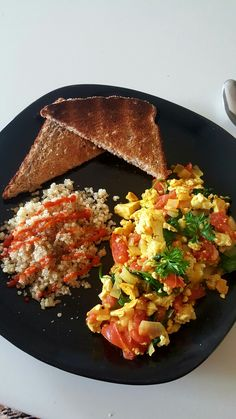 my delicious tofu scramble!   1 Tsp coconut oil .5 small Spanish onion  1/3 package of medium firm tofu  1 Tbsp nutritional yeast  1 tsp garlic powder  1/2 tsp tumeric (for colour) 1/2 roma tomato 1 handful of spinach  Salt and pepper to taste.  This is my favourite breakfast, its fast, yummy and simple