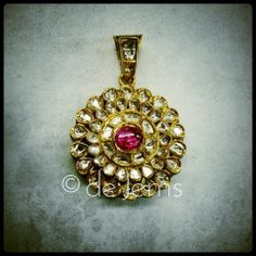 Jadau pendant, ft. uncut diamonds and a pink tourmaline, set in pure gold.