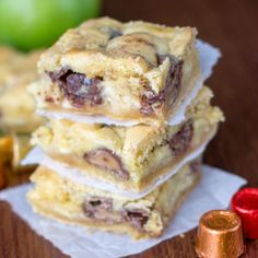 The best gooey bars - cake mix filled with sweetened condensed milk, apples, and Rolos!