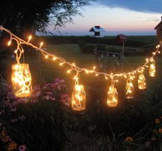 27 Magical Ways To Use Fairy Lights In Your Garden (9) Mason Jar Party, Mason Jars, Glass Jars, Glass Containers, Glass Bottle, Mason Jar Hanger, Deco Champetre, Deco Nature, Deco Originale