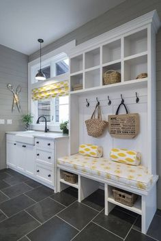 Love the bench with the hooks and cubbies above. Great use of space for our mud room nook.