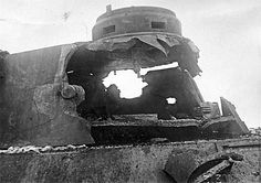 TANKS OF GERMANY. The result of the shot of the Soviet tank ISU-152 on the Tower of the German Panther tank. Battle of Kursk 1943.