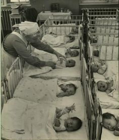 Berlin, 1950.   Oh, those poor little babies want their mamas! I can't believe how long it took hospitals to figure out babies should be cuddled from the very start.