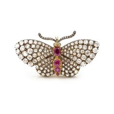 A Victorian en tremblent brooch in the form of a butterfly, the wings set throughout with diamonds and the abdomen set with rubies. Mounted in silver and 18ct yellow gold. English, circa 1850.