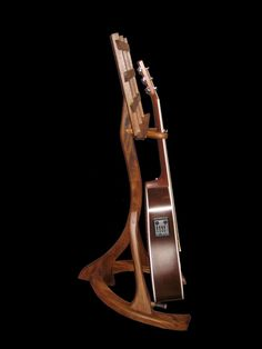 Custom guitar stand made from Afromosia. Designed by Jake with flowing curves. Violin Stand, Ukulele Stand, Music Stand, Music Furniture, Garage Furniture, Guitar Art, Cool Guitar, Wooden Guitar Stand, Guitar Storage