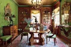 11 Sophisticated Spaces by Timothy Corrigan Inc Photos   Architectural Digest: In the dining room, a Baroque-style waxed-oak table is surrounded by vivid green silk wall panels under a gold-leaf ceiling.
