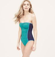 LOFT Beach Colorblock Ruched One Piece Swimsuit - Worn as a bandeau or halter, this colorblocked piece makes the best kind of splash. Removable halter strap. Removable soft foam cups. Lined. To give you the best possible fit, use the following list to match sizes to your cup size: XS=A, S=A/B, M=B/C, L=C, XL=C/D.